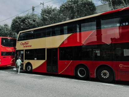 A city flyer bus. Take the A21 bus from the airport to Tsim Sha Tsui.